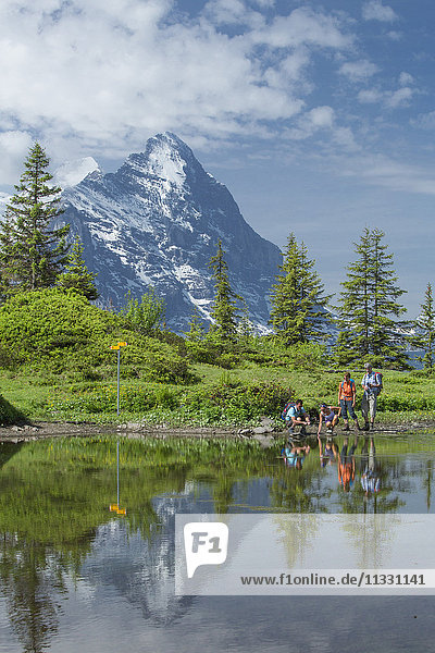 Hiker at a mountain lake on Grosse Scheidegg in the Bernese Oberland  Switzerland