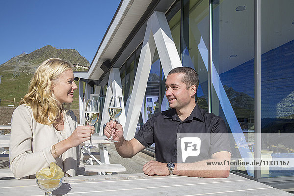 Couple in bar at Corviglia over Saint Moritz  Grisons