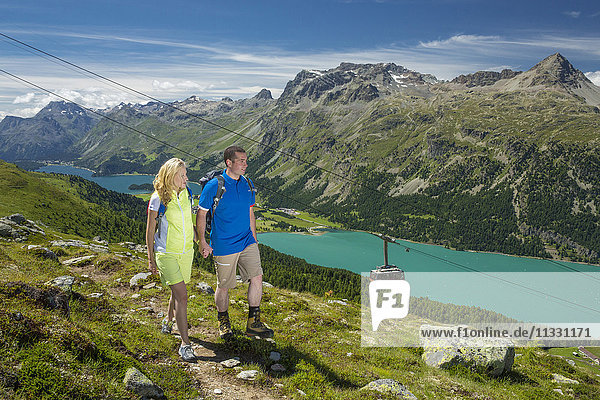 Couple hiking on Corvatsch in Upper Engadine  Grisons