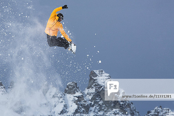 Snowboarder jumping in Laax  Grisons