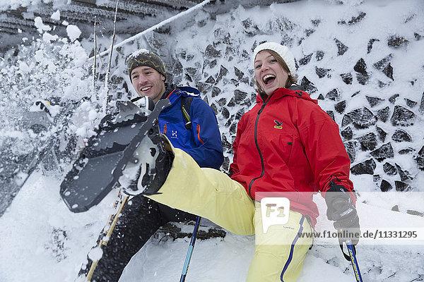 couple doing snow shoe walking in winter in Switzerland