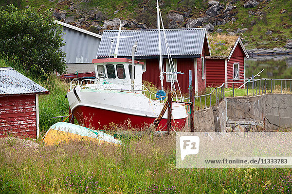 Europe  Norway  Lofoten  Unstad  rorbuer and old boat