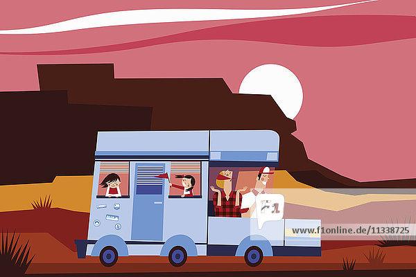 Glückliche Familie fährt mit Wohnmobil in den Urlaub