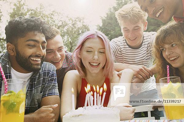 Happy friends celebrating birthday at yard