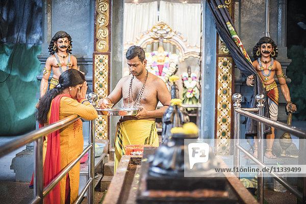 Hindus worshipping and praying at Batu Caves  Kuala Lumpur  Malaysia  Southeast Asia  Asia