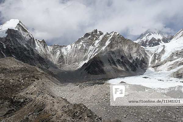 Everest Base Camp at 5350m seen here as a scattering of tents in the distance at the back of the Khumbu glacier  Khumbu Region  Nepal  Himalayas  Asia