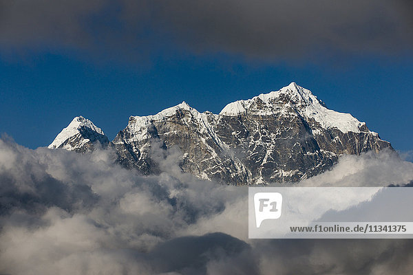 A view of Taboche through the clouds seen from Kongde in the Everest region  Nepal  Himalayas  Asia