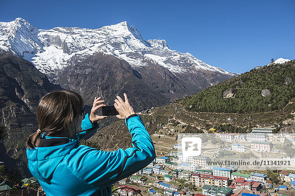 Namche Bazaar is the last town during the trek to Everest Base Camp  seen here with Kongde peak  Khumbu Region  Himalayas  Nepal  Asia