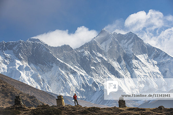 A trekker on his way to Everest Base Camp with Everest the distant peak on the left and Lhotse the peak on the right  Khumbu Region  Himalayas  Nepal  Asia