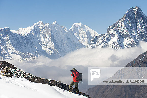 A photographer working in the Everest region of the Nepal Himalayas  Khumbu Region  Nepal  Asia