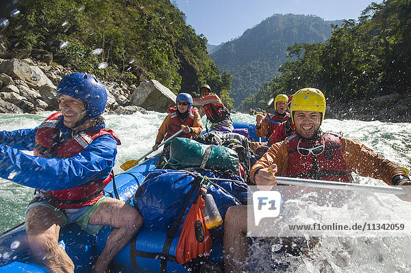 Rafters get splashed as they go through some big rapids on the Karnali River  west Nepal  Asia