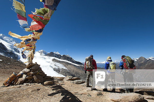 A windy prayer flag strewn cairn marks the top of the Kagmara La  the highest point in the Kagmara Valley at 5115m  Dolpa Region  Himalayas  Nepal  Asia