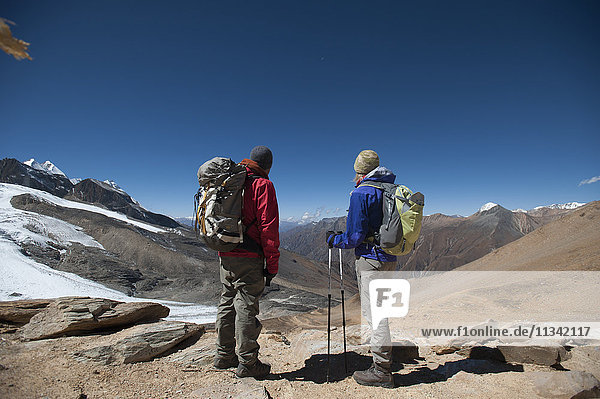 Trekkers at the top of the Kagmara La  the highest point in the Kagmara Valley at 5115m  Dolpa Region  Himalayas  Nepal  Asia