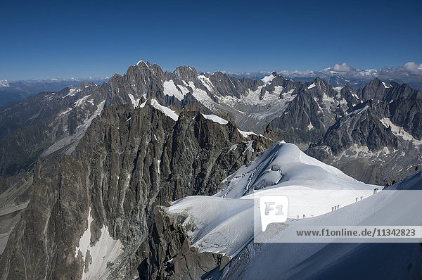 Climbers on a snowfield approaching the Aiguile du Midi  3842m  Graian Alps  Chamonix  Haute Savoie  French Alps  France  Europe