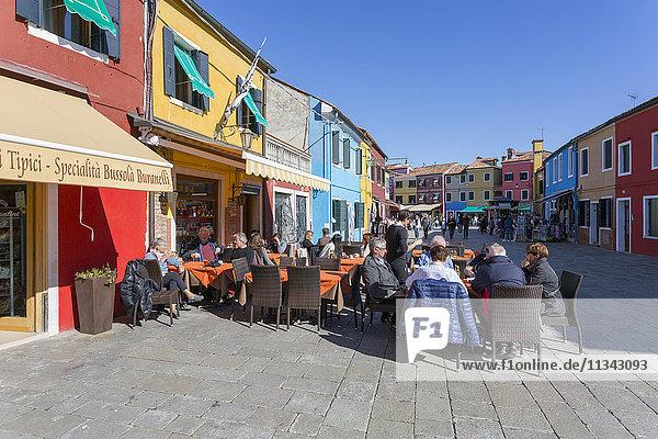 Restaurant and colourful facades  Burano  Veneto  Italy  Europe