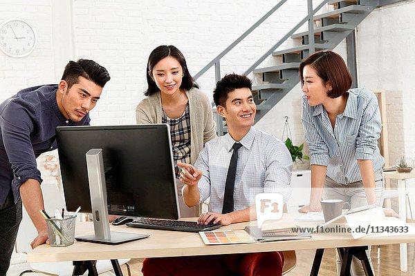 Business men and women work in the studio