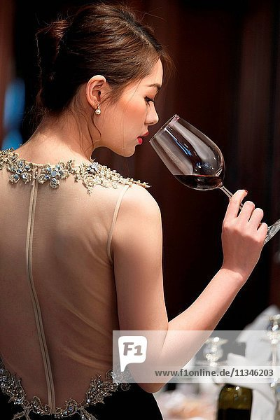Beautiful young women drink red wine