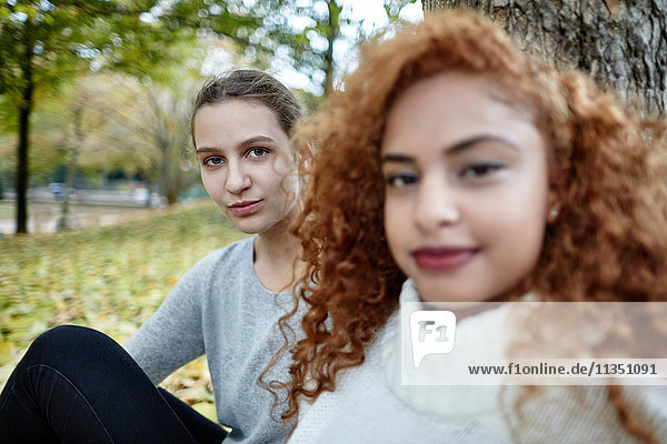 Portrait of young woman with friend in park