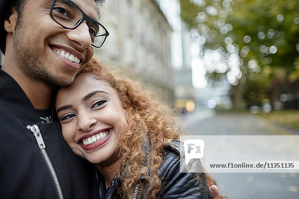Smiling young couple outdoors