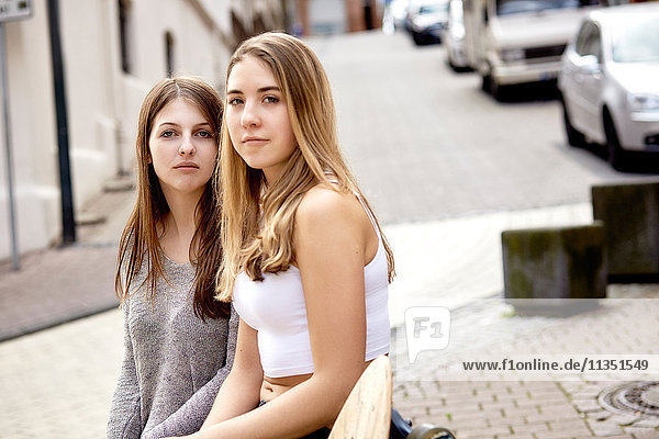 Portrait of two young women with skateboard