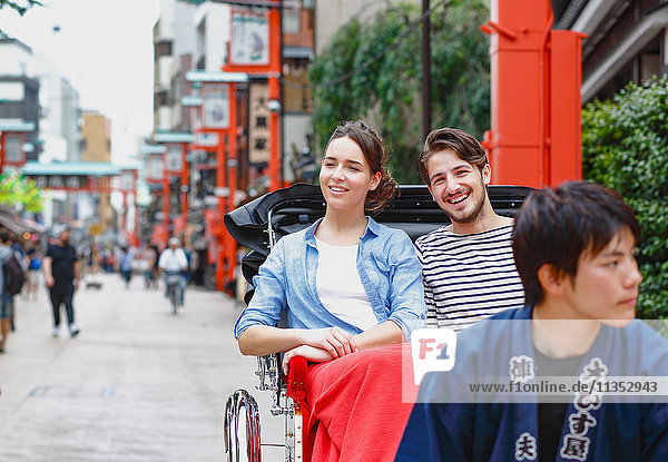 Caucasian couple enjoying sightseeing in Tokyo  Japan