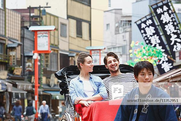 Caucasian couple enjoying sightseeing in Tokyo  Japan