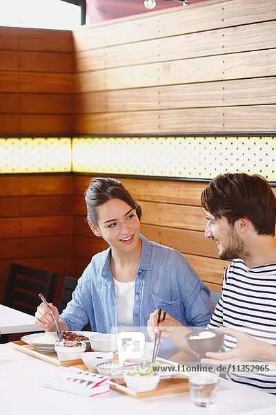 Caucasian couple enjoying Japanese food in Tokyo  Japan