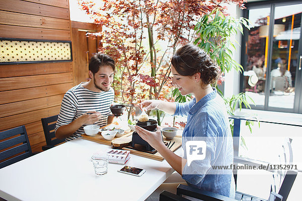 Caucasian couple enjoying Japanese food in Tokyo  Japan