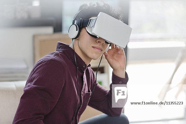 Young man wearing virtual reality headset
