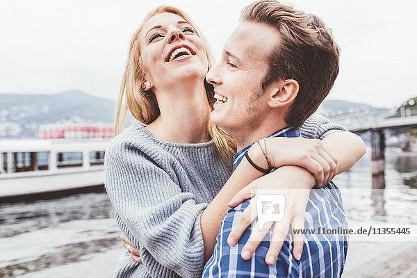 Young couple hugging on lakeside  Lake Como  Italy