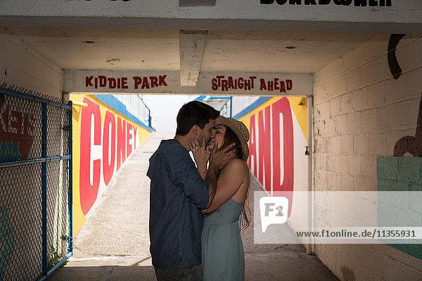 Couple in tunnel kissing  Coney island  Brooklyn  New York  USA