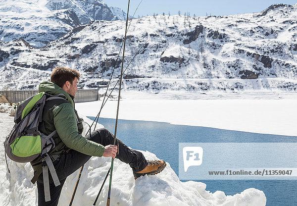 Mid adult man  fishing  Morasco lake  Morasco  Val Formazza  Piemonte  Italy