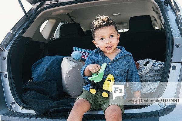 Male toddler sitting on car boot  Pelham Bay Park  Bronx  New York  USA