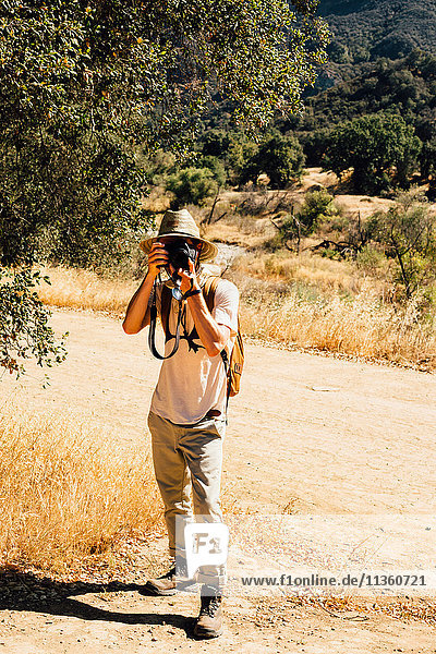Man looking at camera  photographing  Malibu Canyon  California  USA