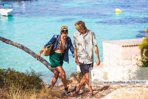 Couple by sea holding hands  Majorca  Spain