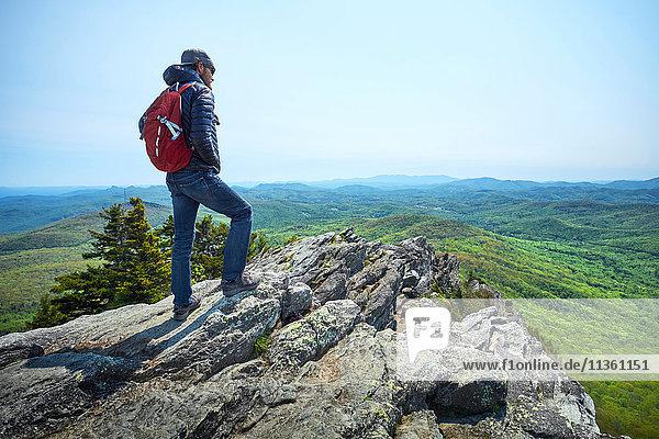 Male hiker looking out from ridge  Blue Ridge Mountains  North Carolina  USA