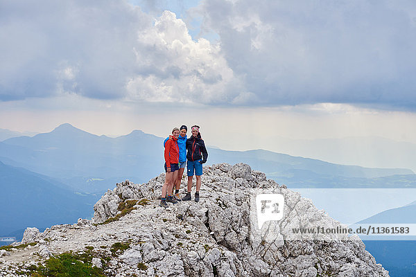 Hikers on top of rocks looking at camera smiling  Austria