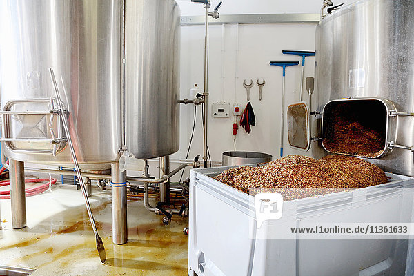 Spent grains from mash tun in large container