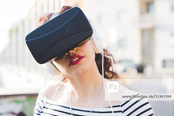 Woman wearing virtual reality and headphones