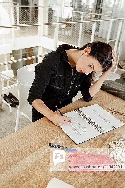 Fashion designer sketching fashion design