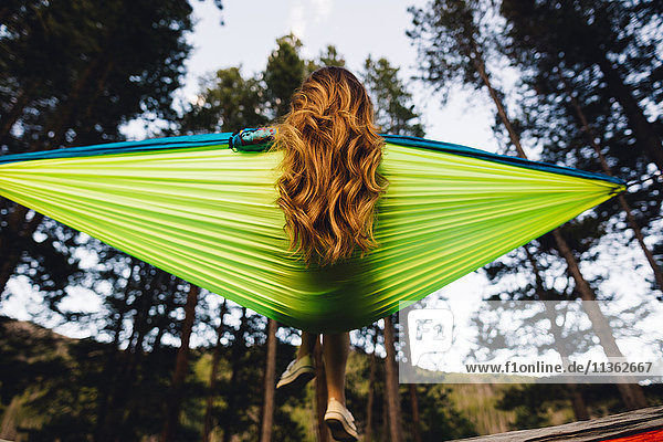 Rear view of woman sitting in hammock  Rocky Mountain National Park  Colorado  USA