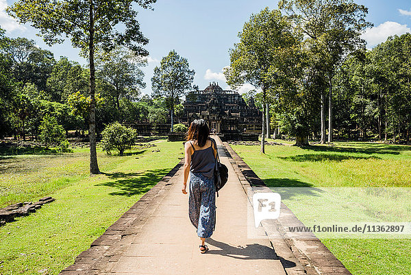 Rear view of woman in garden of Phimeanakas temple  Siem Reap  Cambodia