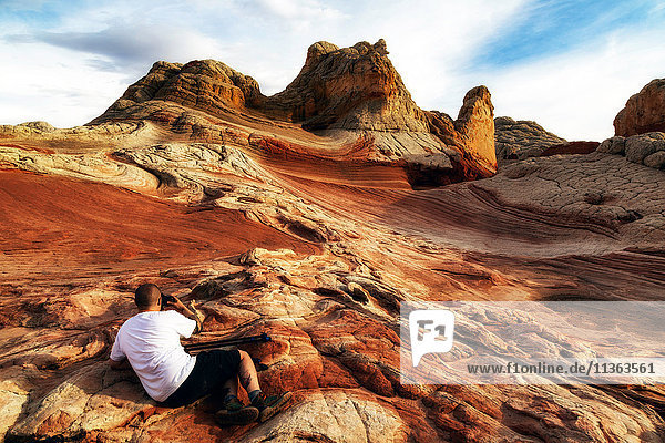 Photographer photographing White Pocket rock formation  Page  Arizona  USA