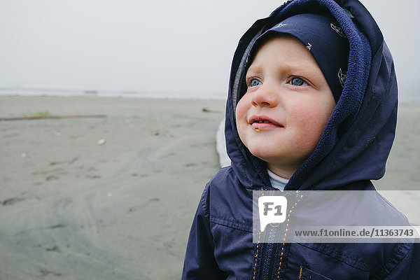 Young boy standing on beach  Long Beach  Vancouver Island  British Columbia  Canada