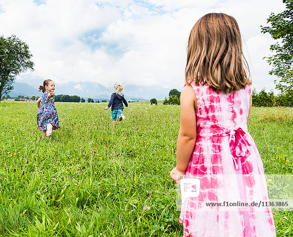 Children running in field  Fuessen  Bavaria  Germany