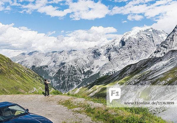 Rear view of woman photographing mountain  Passo di Stelvio  Stelvio  Italy