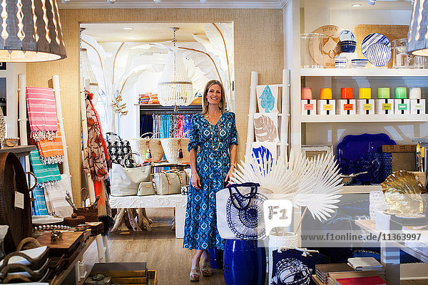 Portrait of mature female shop owner in her stylish boutique