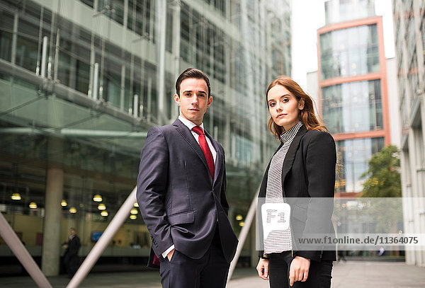 Businesspeople in city looking at camera