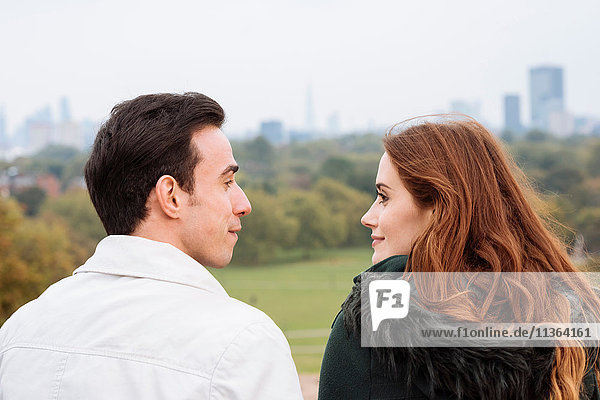 Rear view of couple face to face