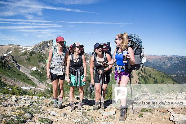 Hikers taking break on hilltop  Enchantments  Alpine Lakes Wilderness  Washington  USA